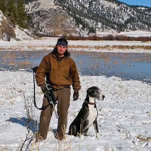 mike Syms with his Rifle and dog